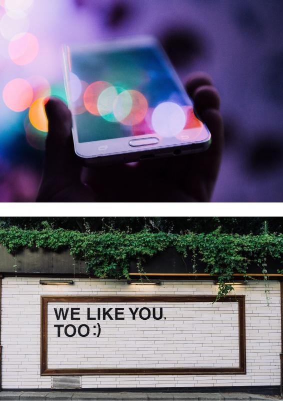 persoon die smartphone vasthoudt + we like you too op muur